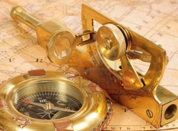 4471128-old-fashioned-navigation-devices-on-a-background-an-old-map