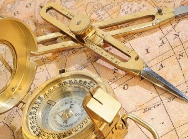 4471181-old-fashioned-navigation-device-on-a-background-an-old-map